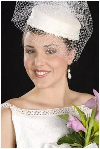 The Pillbox Hat: Beautiful bride wears white hat with white netting