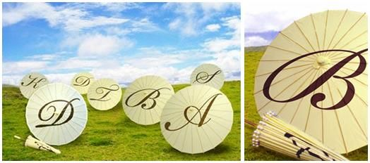 Ivory personalized parasols with monogram initials on top in chocolate brown
