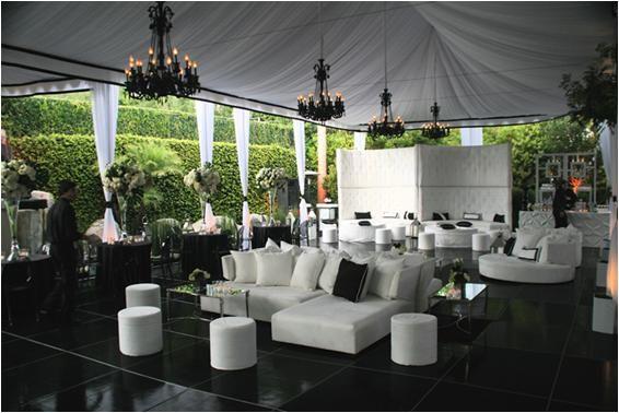 Beautiful white tent, white lounge furniture; black chandeliers make bold statement
