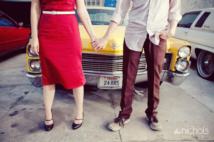 Engagement photo shoot- edgy bride and groom hold hands in front of yellow, vintage cadillac