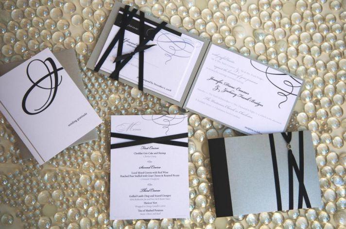 Chic and elegant black, white and grey wedding stationery with black ribbon
