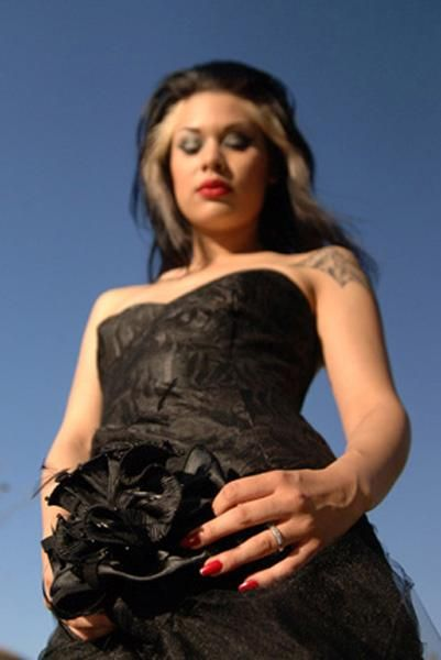 Rock n roll black lace strapless wedding dress edgy bride with red lips and