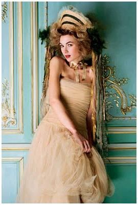 Ecru tulle covers this gold and tan dress, draped and ruched up top, gathered tulle skirt
