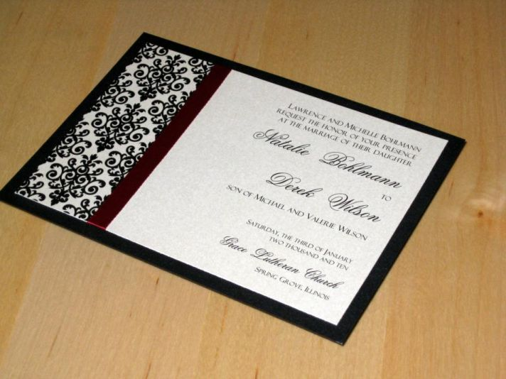This ivory and black invitation has deep red and maroon accent colors.