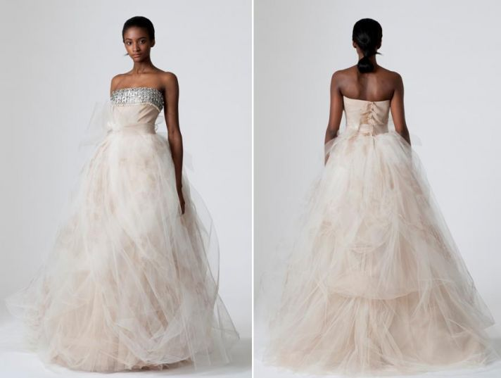 Strapless very light blush pink tulle wedding dress from Vera Wang with silver rhinestone band at to
