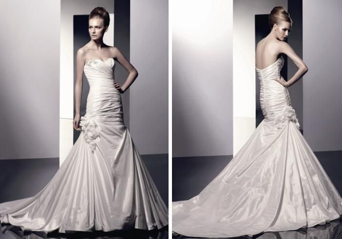 Gorgeous drop waist wedding dress with large floral accent and full mermaid skirt