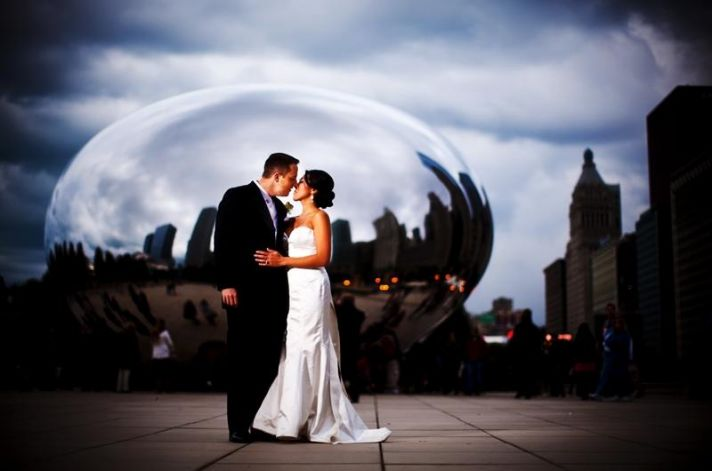 """Bride and groom pose in Millennium Park in front of """"The Bean"""""""