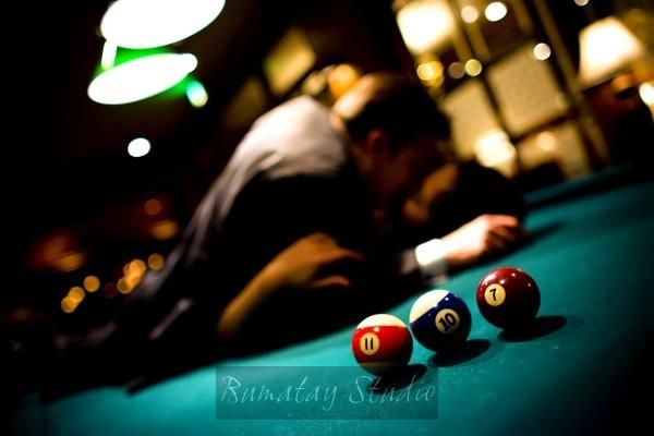 Pool balls spell out the couple's wedding date- perfect for a save the date!