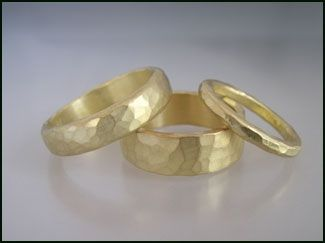 Hammered gold wedding bands made from post-consumer gold