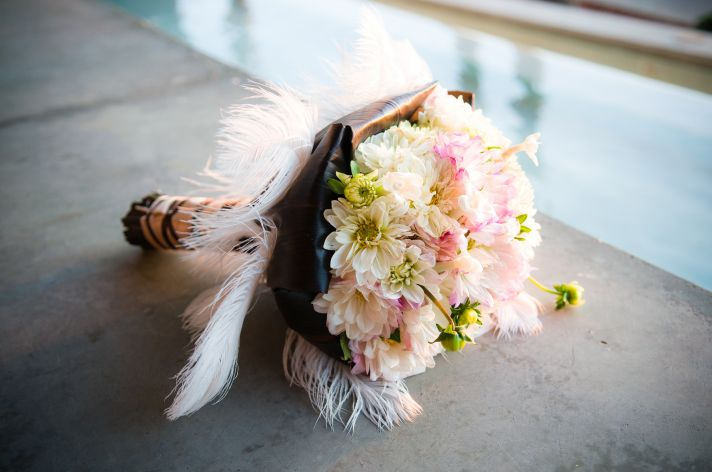 Romantic light pink, ivory, green bridal bouquet adorned with whimsical feathers