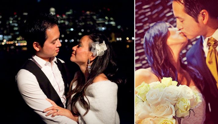 Bride and groom outside on cruise ship in front of beautiful city skyline