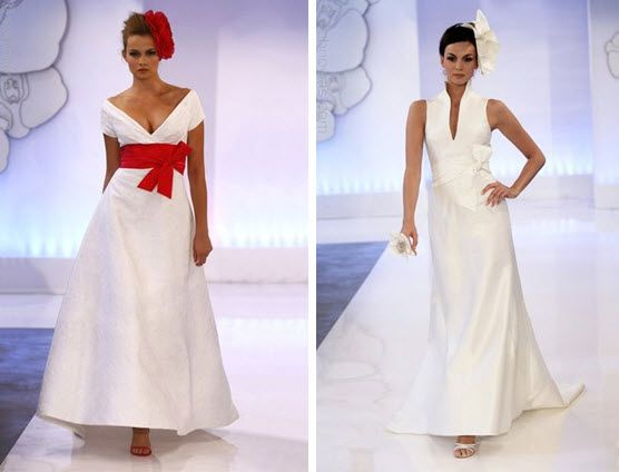 Classic white Cymbeline wedding dress with deep red sash and floral hairpiece