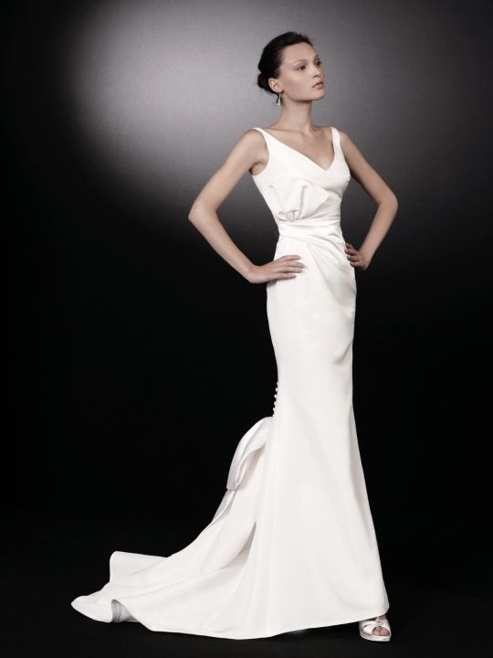 Stunning structured white wedding dress with modified mermaid silhouette and covered buttons