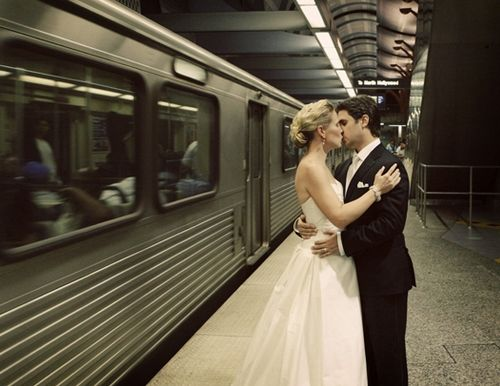 Bride and groom go green- kiss outside metropolitan subway, eco-chic wedding transportation