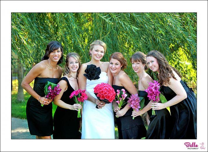 Bridesmaids wear their own little black dresses, hold unique pink bridesmaids bouquets