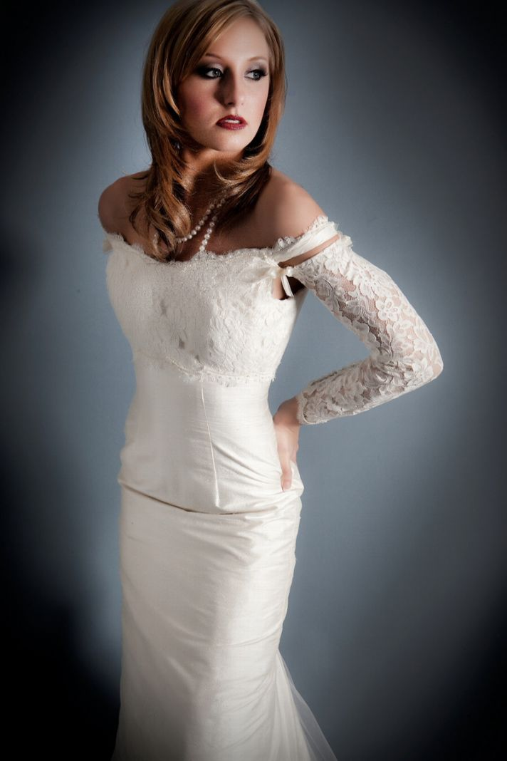 Classic and modern bridal look- off-the-shoulder neckline, long sleeved wedding dress