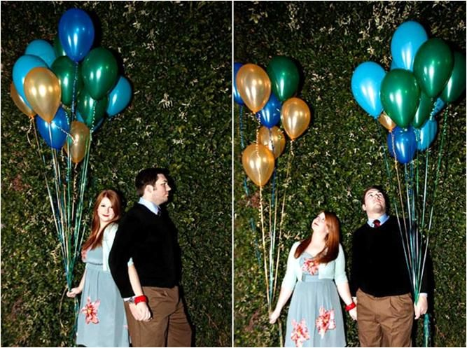 Bride and groom pose in front of lush green bushes, hole balloons in their wedding colors