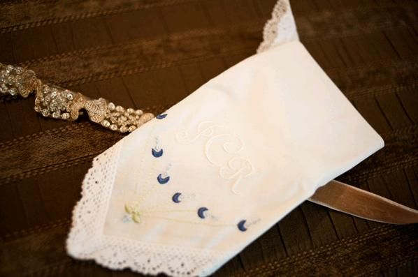 The bride's vintage chic something blue- a white handkerchief embroidered with blue designs