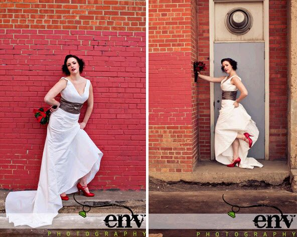 Vintage styled retro bride poses with statement bridal bouquet in front of brick wall
