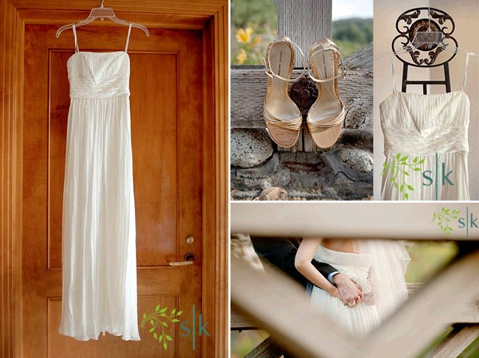 White BCBG sheath style wedding dress hangs on wood door; bride's open toe strappy bridal heels sit