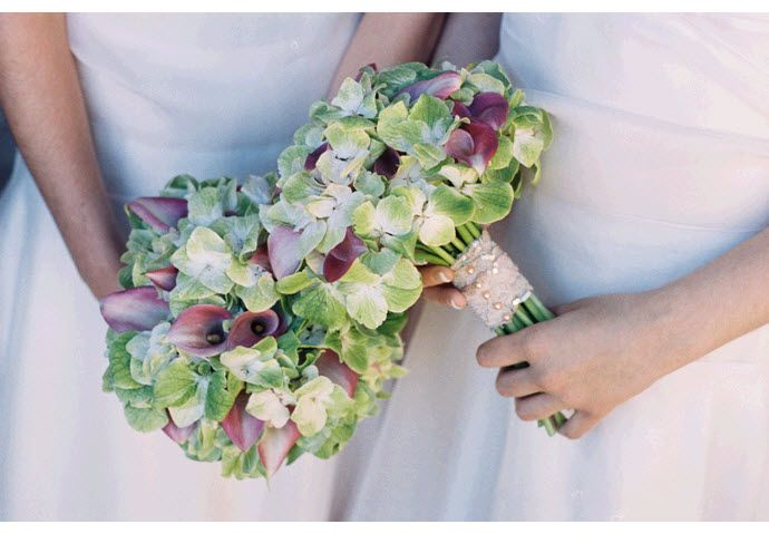 Romantic and whimsical pink, light green, and ivory bridesmaids' bouquets