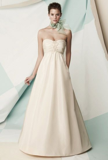 Empire ivory Mikaella wedding dress with full a-line silhouette