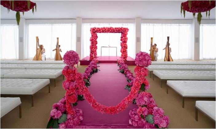Gorgeous pink wedding arbor created from paved peonies