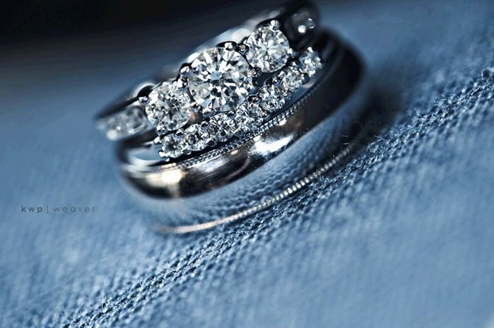 Stunning engagement ring and wedding band photo with blue jean background