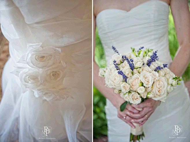 Bride wear's simple strapless white wedding dress, holds gorgeous classic bridal bouquet