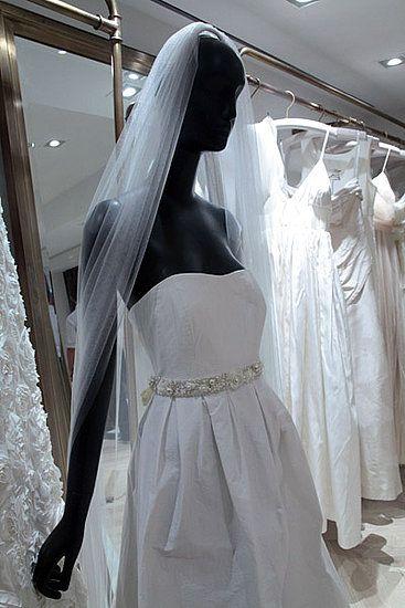 Off white strapless J.Crew wedding dress with jeweled belt