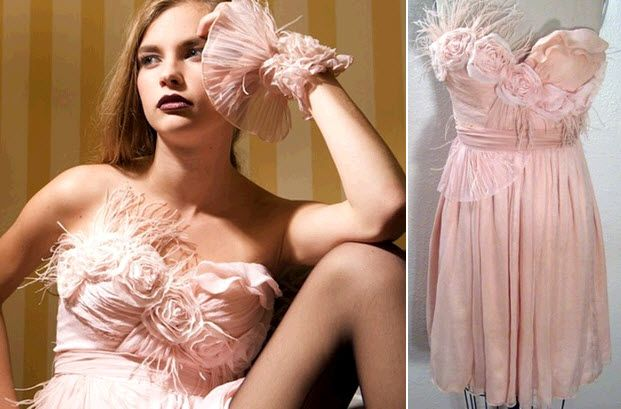 Feminine and flirty blush pink strapless dress with rosette applique and feather details