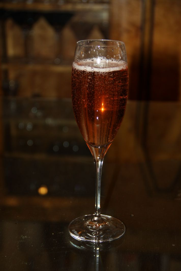 This red cocktail in a champagne flute would be perfect for any red themed party.