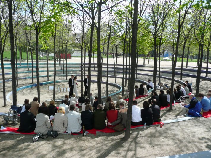 This outdoor wedding ceremony took place in a park in Spain.
