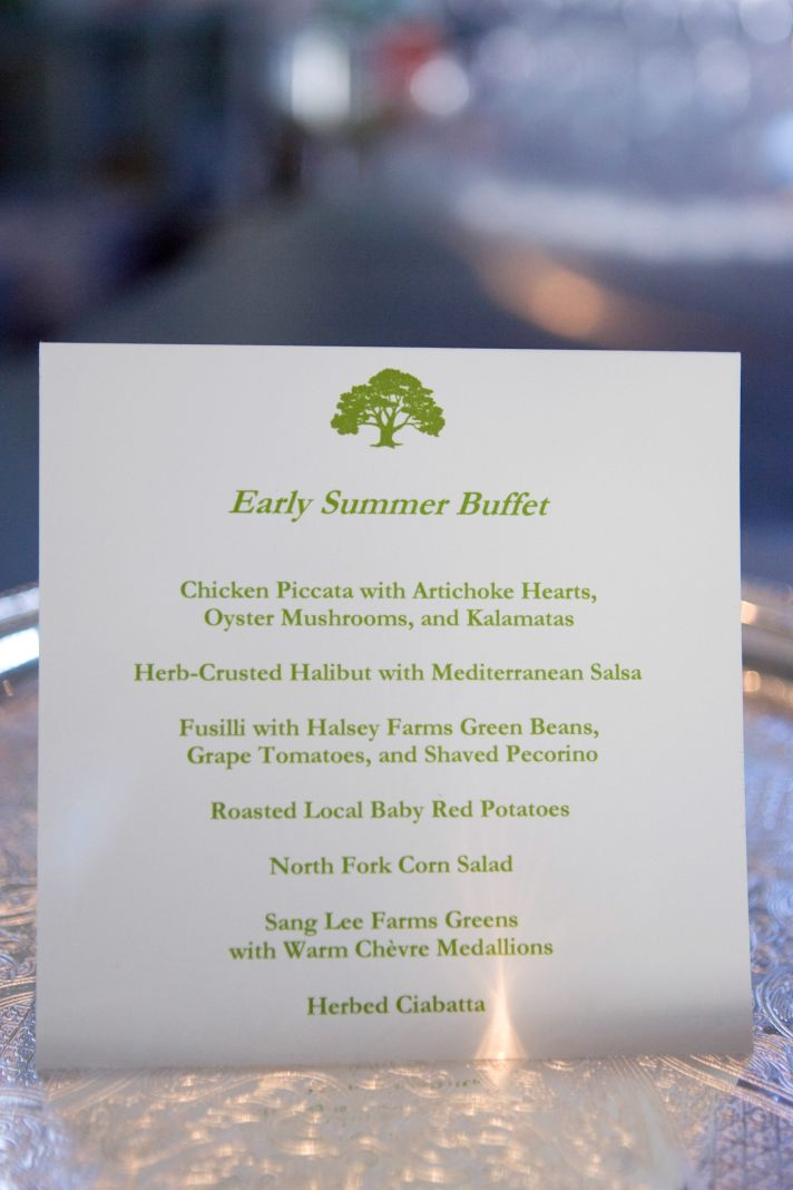 This wedding menu features green writing and a tree motif.