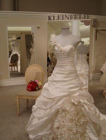 Stunning ivory asymmetric ballgown wedding dress with ruffled skirt by Pnina Tornai