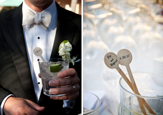 groom-wears-black-tux-cream-bowtie-holds-cocktail-at-wedding-reception-personalized-wedding-details