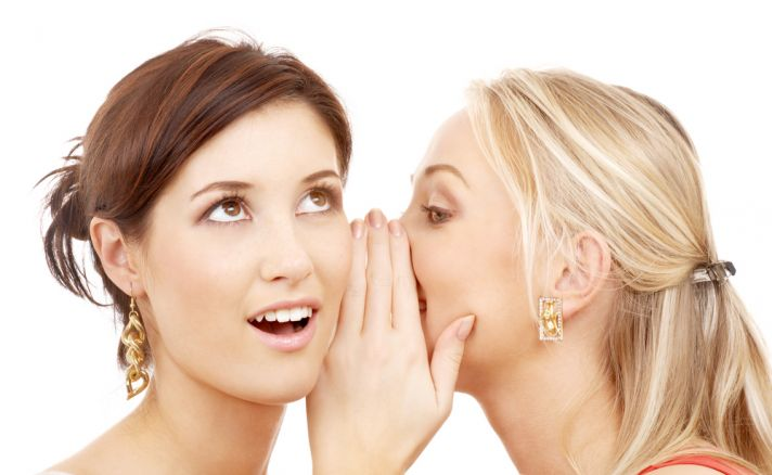 Are these two bridesmaids whispering about the bride?