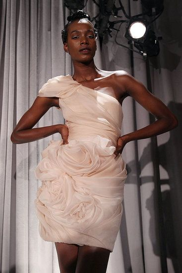 This short wedding dress is pink with flowers and designed by Marchesa.