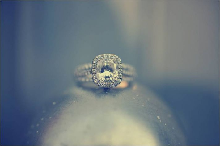 Cushion cut diamond engagement ring photographed on silver dome