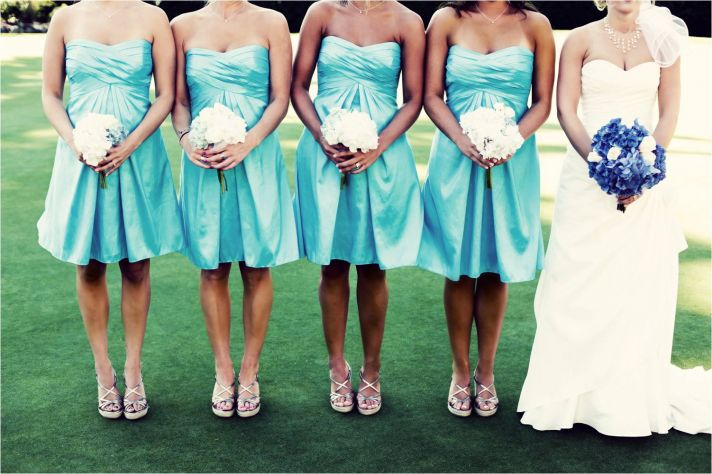 Aqua strapless bridesmaids dresses and white bridesmaid bouquets