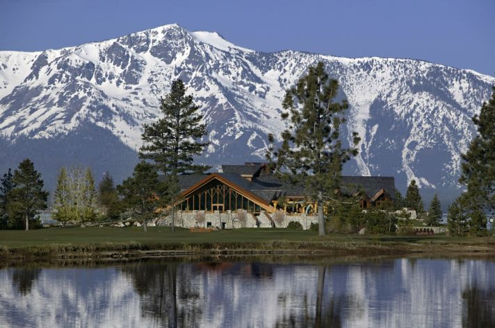 Rustic wedding venue in Lake Tahoe with snow-covered mountains in back