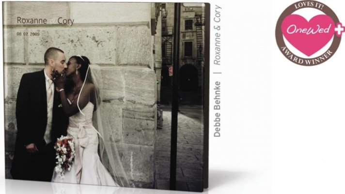 This bride and groom kiss on the cover of their make-your-own wedding album.