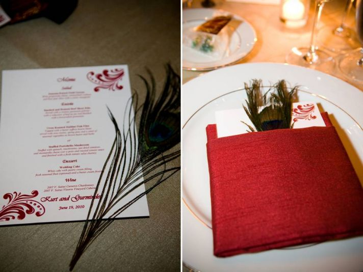 Red, white and gold wedding reception decor and stationery with peacock feather details