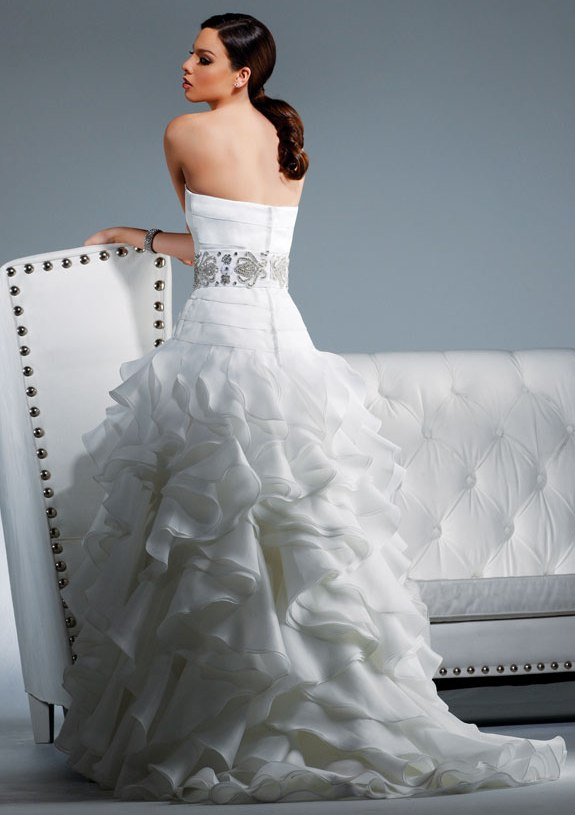 Strapless white wedding dress with gorgeous jeweled cumberbund and ruffled