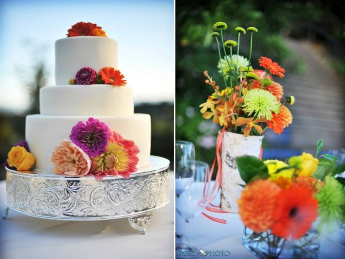 Classic three-tier white wedding cake adorned with bright Gerbera daisies