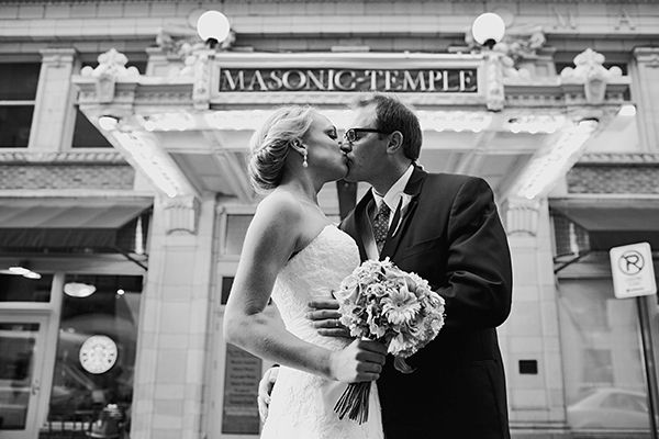 Bride and groom kiss outside gorgeous Des Moines venue after saying I Do
