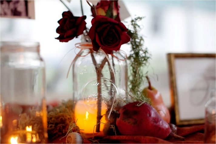 Rustic autumn wedding reception decor single red rose in mason jar and lots