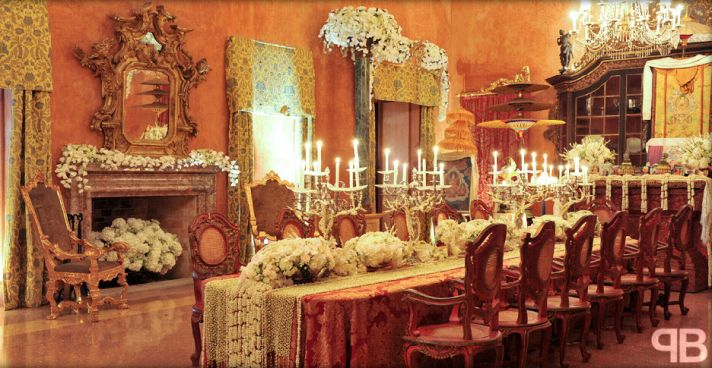 Regal and rich wedding reception decor- unique tables and chairs