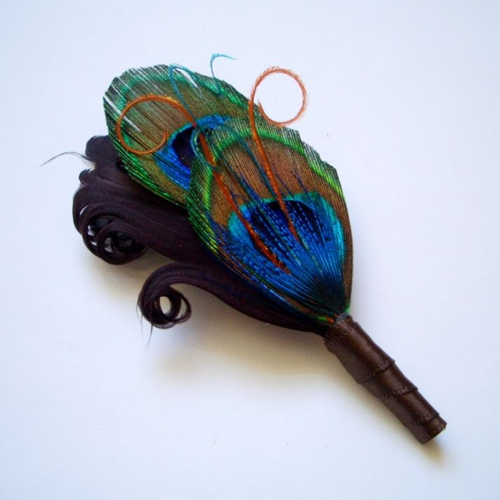 Peacock feather boutonniere for the groom
