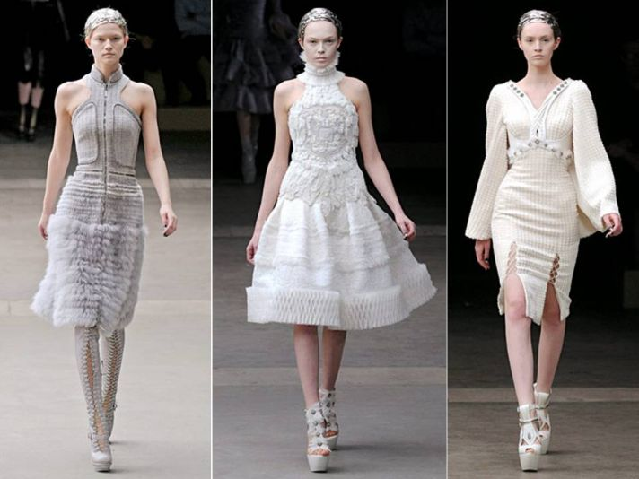 Breathtaking ivory couture gowns with feather embellishments by Alexander McQueen